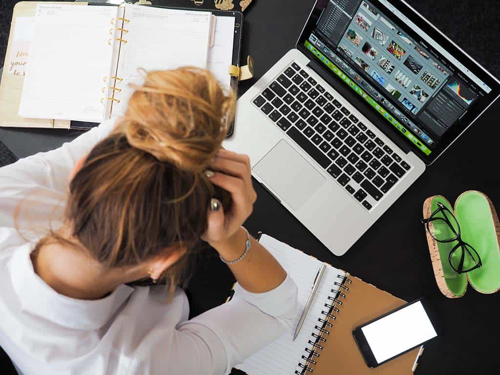 harming your health work related stress for woman at work laptop