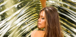 best coconut oil brands for skin and hair woman palm trees